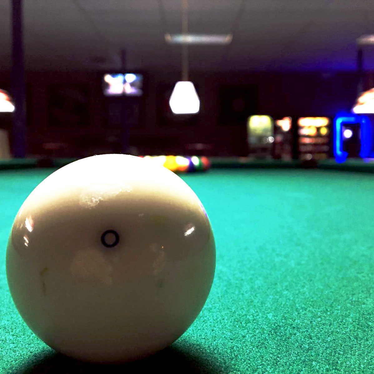 Cue ball waiting to hit the rack.