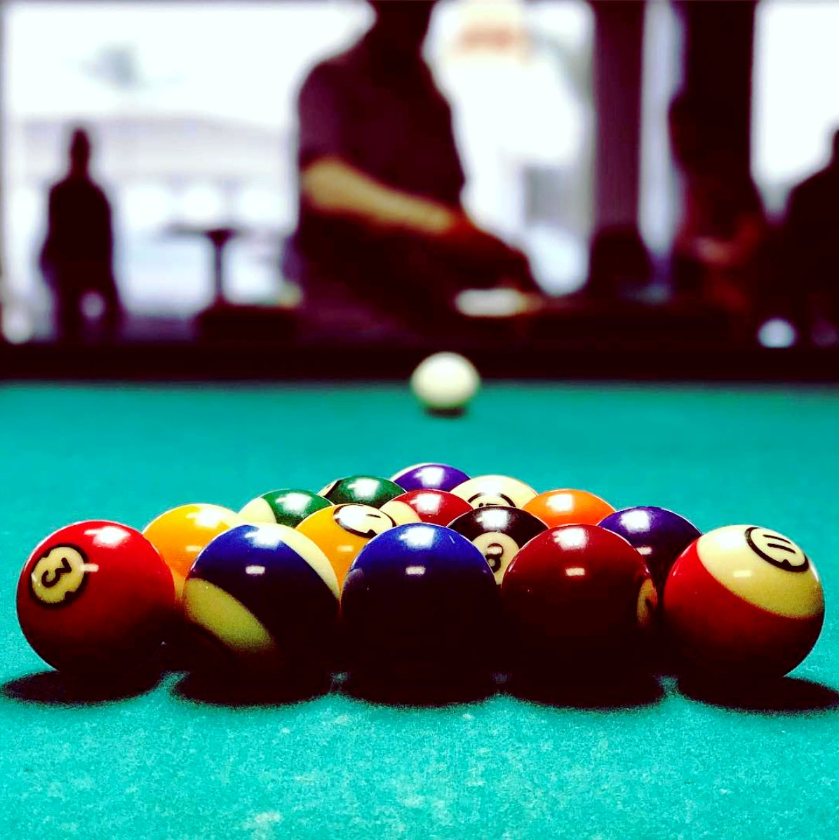 Pool player gets ready to play pool.